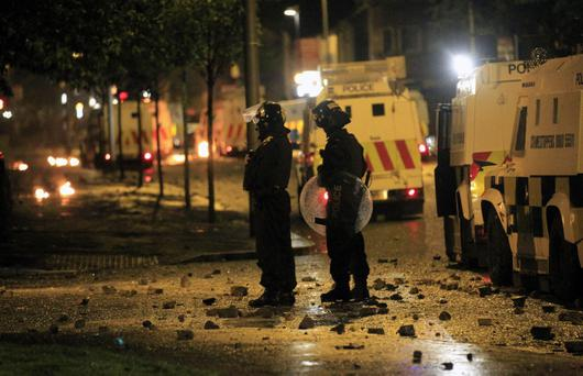 Northern Ireland police officers patrol in East Belfast, Northern Ireland, Wednesday, June 22, 2011. Rioting began for the second night between Catholic and Protestant gangs. (AP Photo/Peter Morrison)