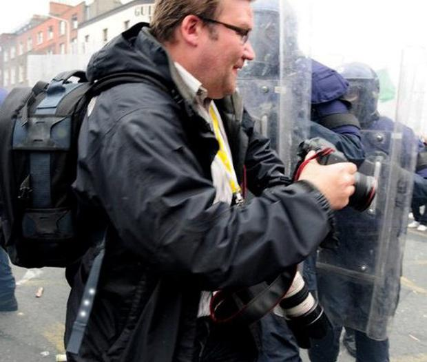 Niall Carson who was shot in the leg during the second night of Belfast rioting.