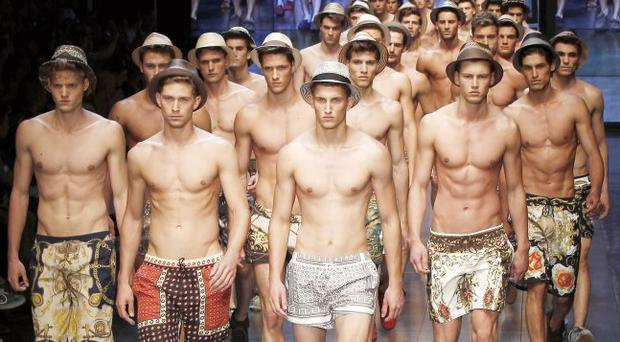 Models wear creations of D&G men's Spring-Summer 2012 collection, part of the Milan Fashion Week, unveiled in Milan, Italy, this week.