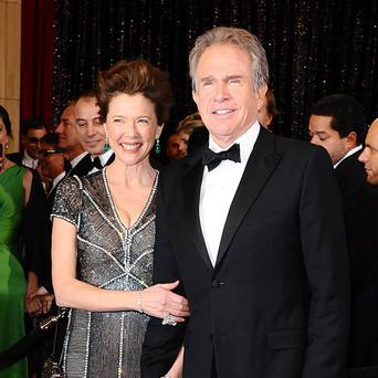 Warren Beatty, pictured with wife Annette Bening, is set to return to directing