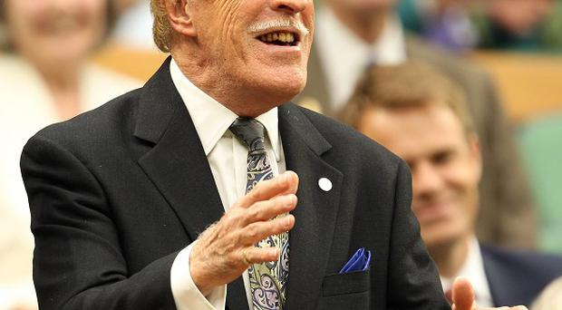 Sir Bruce Forsyth played up to the crowd as he arrived in the royal box