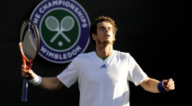 Andy Murray cruised into round three at Wimbledon with a 6-3 6-3 7-5 victory over German Tobias Kamke yesterday