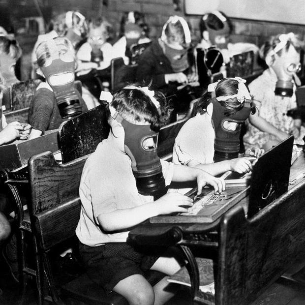 Children wearing gas masks at a school in Clerkenwell, north London, as a precaution against gas attack