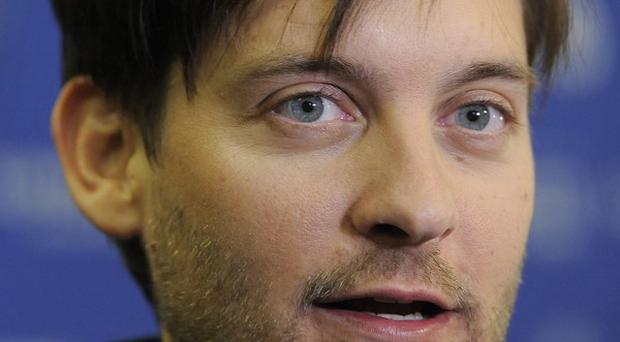 Tobey Maguire and other celebrities are being sued over poker matches (AP)