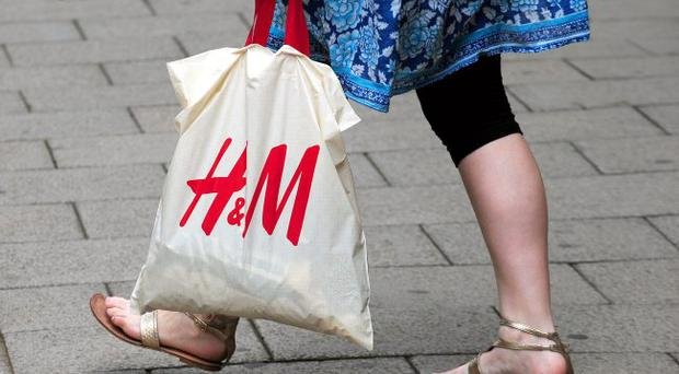 A general view of a customer carrying a bag as they leave an H&M store in Nottingham city centre. PRESS ASSOCIATION Photo. Picture date: Wednesday June 22, 2011. Fashion retailer H&M underlined the challenges on the high street today after high cotton prices and a drop in consumer spending power hit profits. The Swedish chain, which has 2,297 stores worldwide including more than 180 in the UK, reported a 23% drop in pre-tax profits in the six months to May 31 to 9.3 billion Swedish krona (£900 million). See PA story CITY HM. Photo credit should read: Rui Vieira/PA Wire