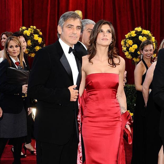 George Clooney and Elisabetta Canalis have appealed for privacy