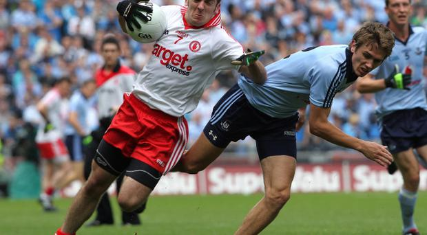 Philip Jordan (left) is part of a very experienced Tyrone defence that will have its work cut out against a youthful Donegal attack