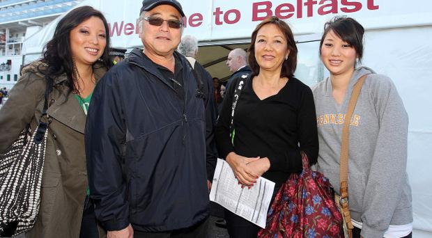Americans Erin Tanaka with her father Don, mother Karen and sister Christine arrive in Belfast