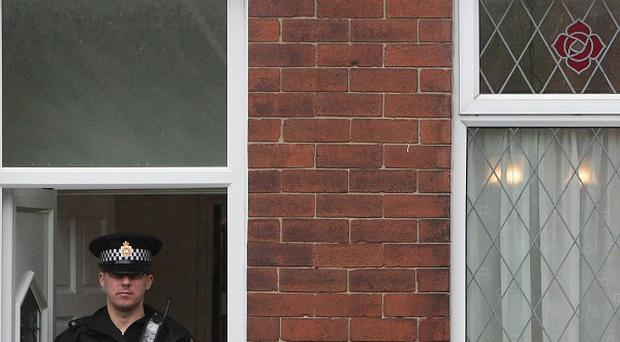 Police at the scene in Salford, Greater Manchester