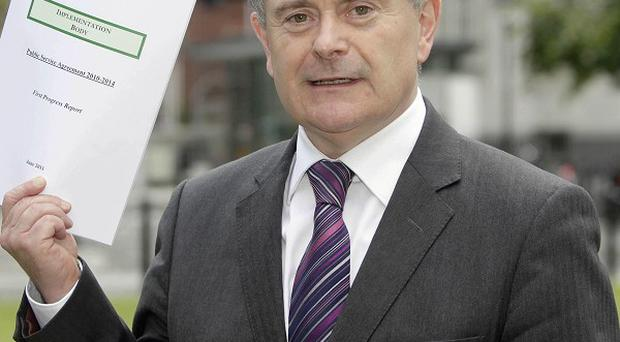Minister for Public Expenditure and Reform Brendan Howlin says top- earning civil servants and judges are being hit with huge pay cuts