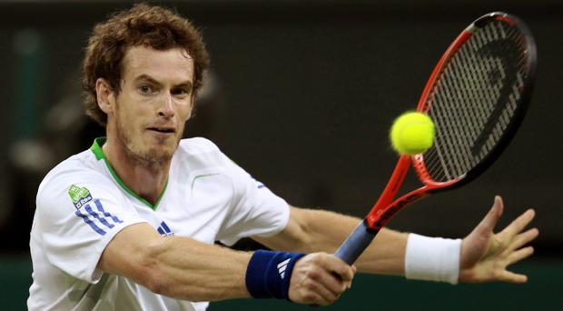 Andy Murray on his way to a hard fought victory over Ivan Ljubicic and a place in the fourth round at Wimbledon last night on Centre Court