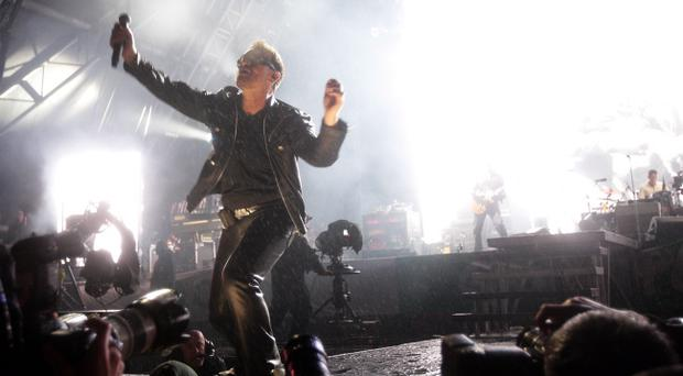 GLASTONBURY, ENGLAND - JUNE 24: Bono of U2 performs at the Glastonbury Festival at Worthy Farm, Pilton on June 24, 2011 in Glastonbury, England. The festival, which started in 1970 when several hundred hippies paid 1 GBP to watch Marc Bolan, has grown into Europe's largest music festival attracting more than 175,000 people over five days. (Photo by Dave J Hogan/Getty Images)