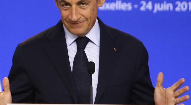 French President Nicolas Sarkozy has criticised the US over its stance on Libya (AP)