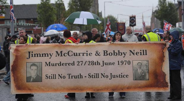 Family members join in the parade at the memorial garden on the Newtownards Road yesterday in memory of Jimmy McCurrie and Robert Neill, who were killed by the IRA in June, 1970
