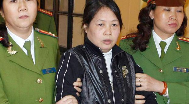 Tran Khai Thanh Thuy is escorted from a courtroom in Hanoi, Vietnam (AP)