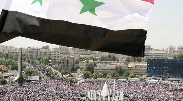 Syrian security forces have opened fire on protesters in several cities including Damascus, Barzeh and Homs (AP)