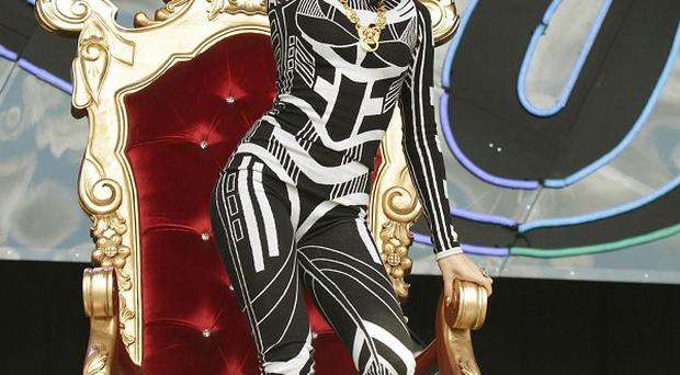 Jessie J performing at Glastonbury with her leg in a cast