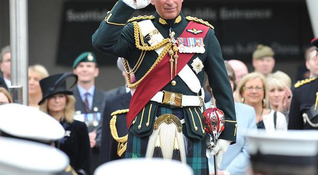 The Prince of Wales takes the salute from Sea Cadets during the Armed Forces Day parade in Edinburgh