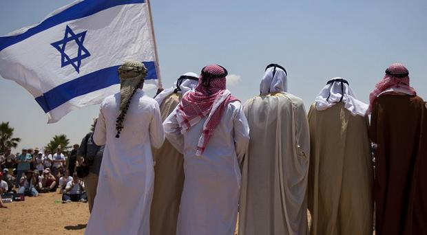 Israelis and Bedouins attend a ceremony to mark the anniversary of the soldier Gilad Schalit's kidnap (AP)
