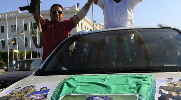 Supporters of Libyan leader Muammar Gaddafi at Green Square in downtown Tripoli (AP)