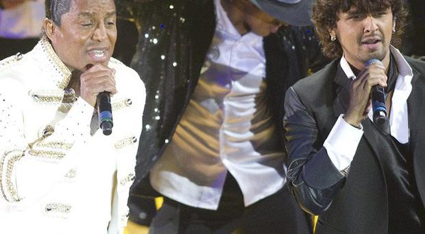 Jermaine Jackson and Sonu Nigam perform during the International Indian Film Academy Celebrations in Toronto (AP/The Canadian Press)
