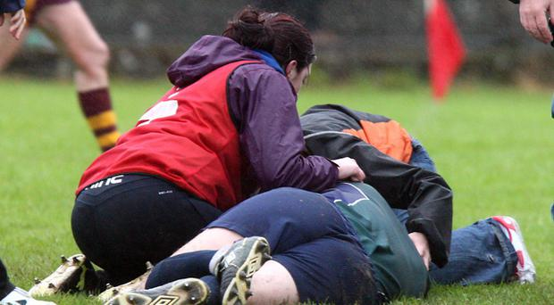 A referee knocked unconcious after the Tyrone senior women's game yesterday between St Macartan's and Carrickmore at Beragh