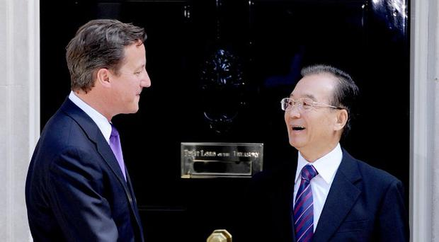 David Cameron and Chinese premier Wen Jiabao, who said Britain and Beijing had to treat each other as 'equals' on human rights