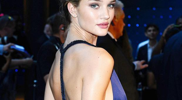 Rosie Huntington-Whiteley arrives at the UK fan screening of Transformers: Dark Of The Moon