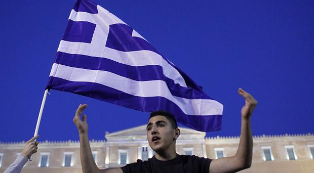 A young protester shouts slogans in front of the Greek parliament during a protest against austerity measures (AP)