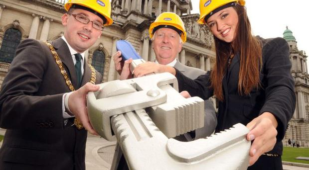 Belfast's new Lord Mayor, Councillor Niall O Donnghaile, launches the Apprentice of the Year Awards, assisted by Ciara McStravick and Derek Poole, chairman of Plumbing and Mechanical Services Training