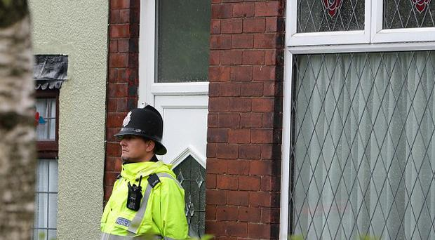 The scene where a suspected burglar was stabbed to death in Salford, Greater Manchester
