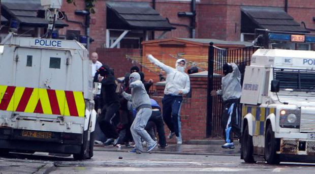 Homes in East Belfast's Short Strand area are under attack by a groups of rioters