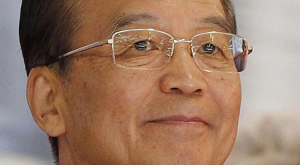 Chinese premier Wen Jiabao will meet German Chancellor Angela Merkel