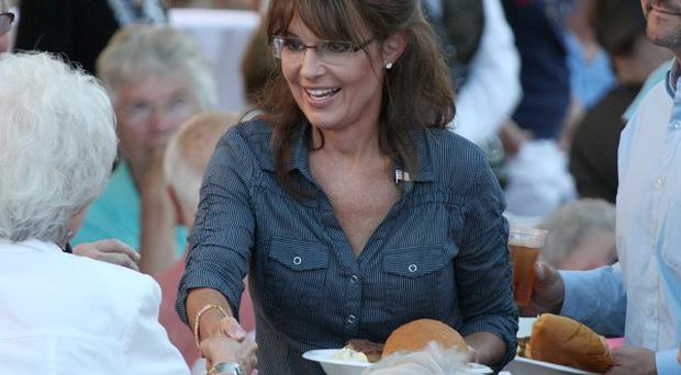 Sarah Palin greets supporters during a barbecue after the screening of the film The Undefeated in Pella, Iowa (AP)