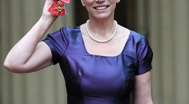 Annie Lennox received her OBE from the Queen