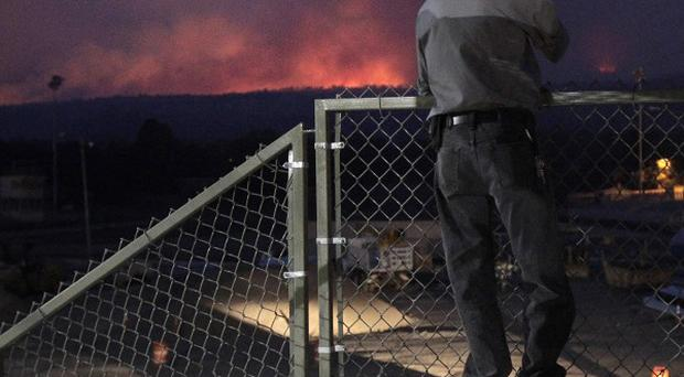 Los Alamos residents watch flames from the Las Conchas fire in New Mexico (AP)