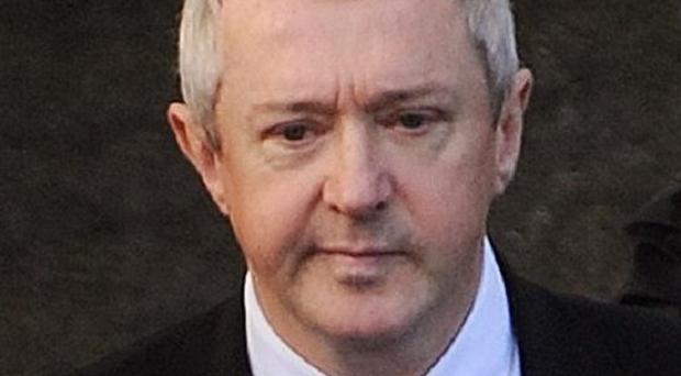 A man has been charged with falsely accusing X-Factor judge Louis Walsh of groping him in a nightclub
