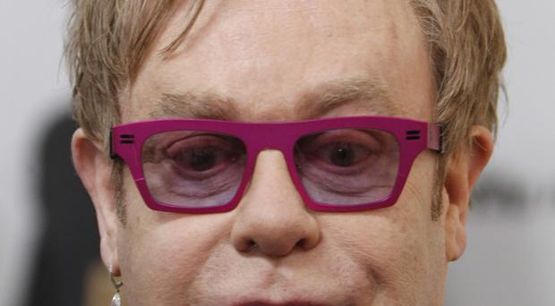 Sir Elton John has found happiness being a dad