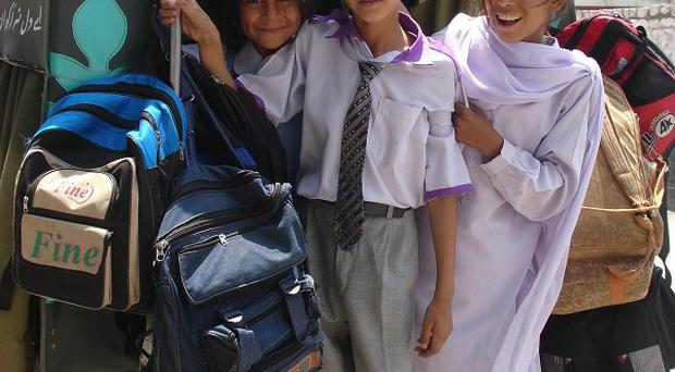 Pupils fromf Pakistani Government Girls Comprehensive Higher school in Abbottabad, Pakistan which has lost its link to British schools(AP)