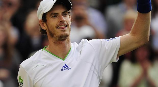 Andy Murray celebrates defeating Spain's Feliciano Lopez during day nine of the 2011 Wimbledon Championships