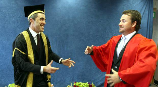 Chancellor of the University of Ulster ,Northern Ireland-born actor Dr James Nesbitt jokes with Former US Open golf champion Graeme McDowell. in the robing room prior to a graduation ceremony, at the Coleraine campus