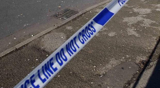 A man has been arrested after a 29-year-old woman was found dead on a street in Co Antrim
