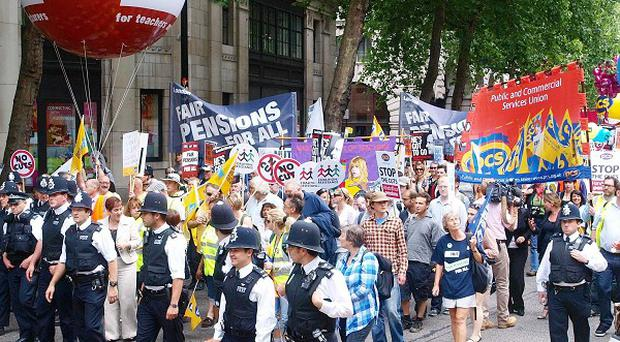 Police lead public service employees through London as the biggest outbreak of industrial unrest since the coalition was formed took place