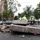 Belfast City Council workers clear up the debris on the Lower Newtownards Road.