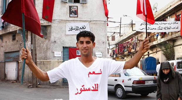 A man wears a t-shirt which has 'I say yes to constitution' printed on it in Casablanca (AP)
