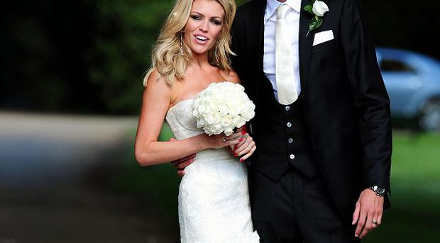 Abbey Clancy and Peter Crouch posed for pictures at the gates of the venue