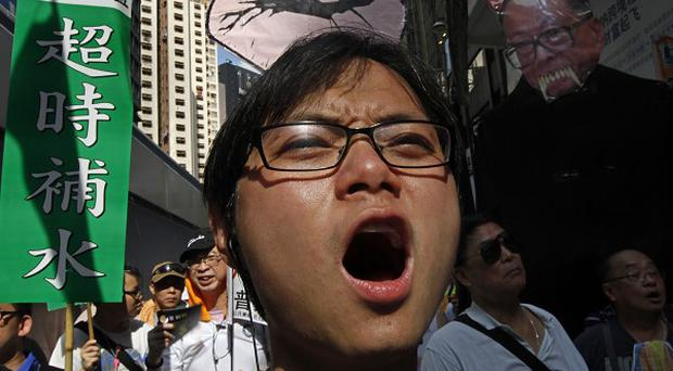 Thousands of protesters demonstrated against rising property prices in Hong Kong (AP)