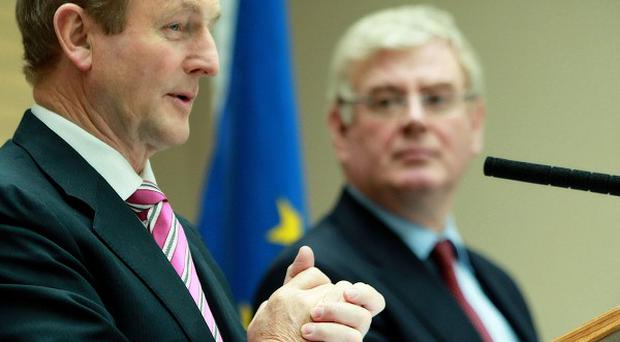Taoiseach Enda Kenny and Tanaiste Eamon Gilmore at the launch of the first Irish Short-Stay Visa Waiver Programme