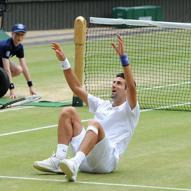 Serbia's Novak Djokovic celebrates winning the Wimbledon men's title