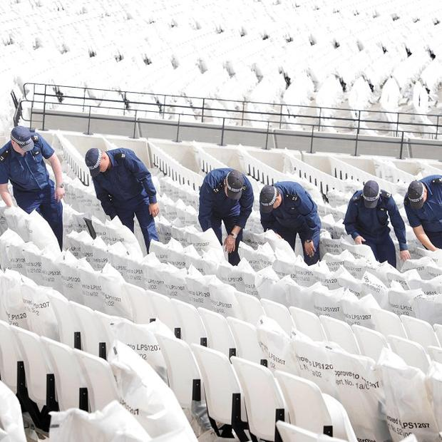 Police officers take part in a security search exercise at the Olympic Stadium in Stratford, east London